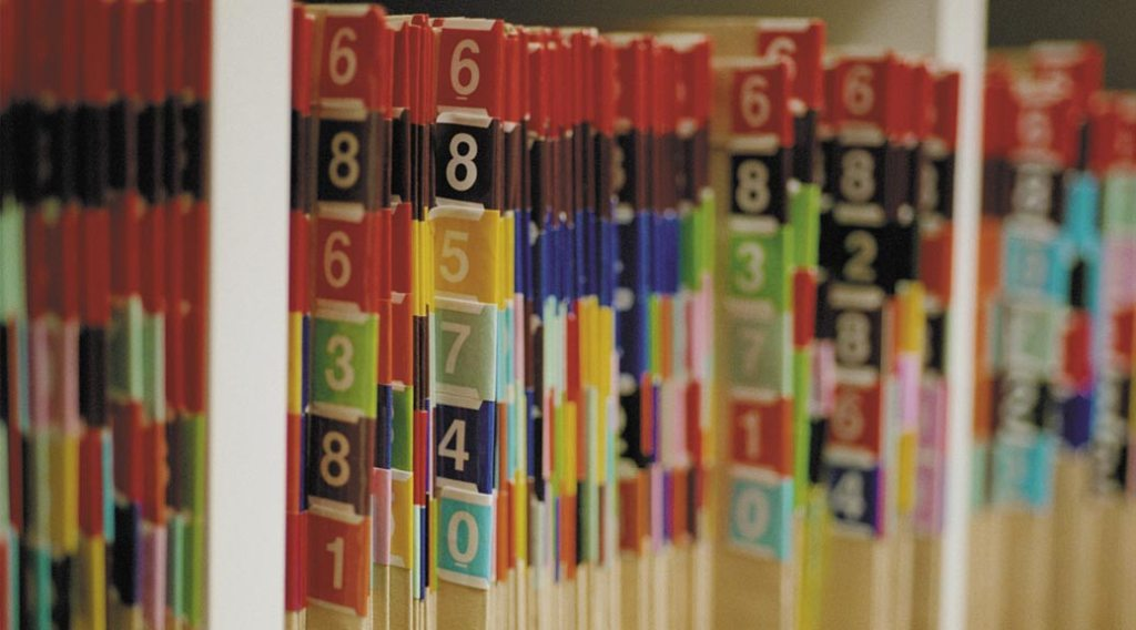 Medical records folders on a shelf