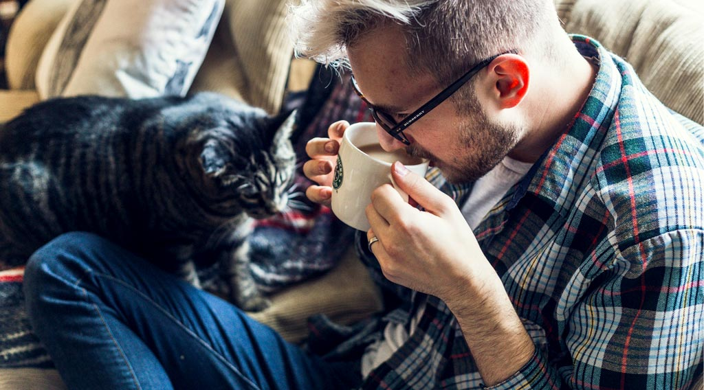 Man on sofa with cat