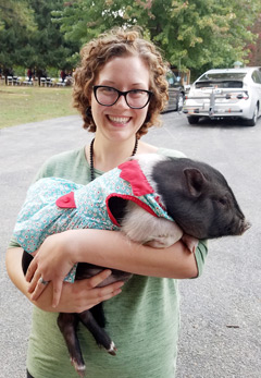 Registered Veterinary Technician Cass and her pig