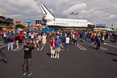 Space Shuttle Endeavor in a parking lot for public viewing.