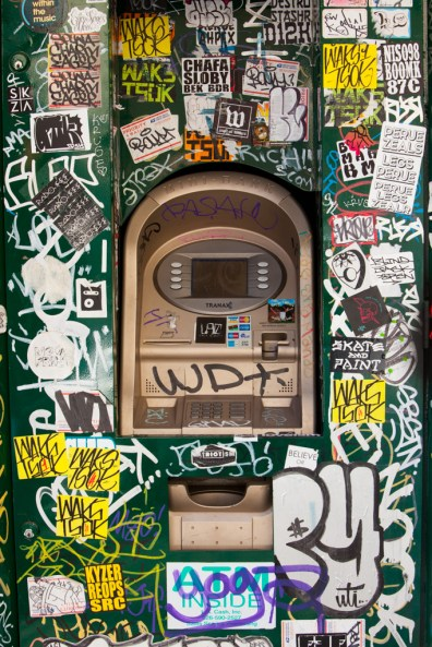 ATM machine covered with stickers, Los Angeles, California, USA