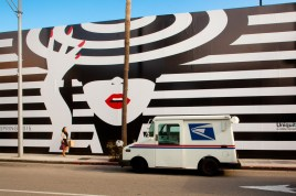 Mail truck in front of a store building wrapped while under construction, Beverly Hills, California