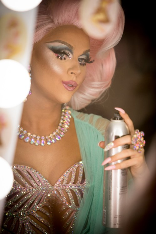 Farrah Moan touches up her makeup at RuPaul's DragCon 2017, Los Angeles Convention Center, downtown LA, California, USA