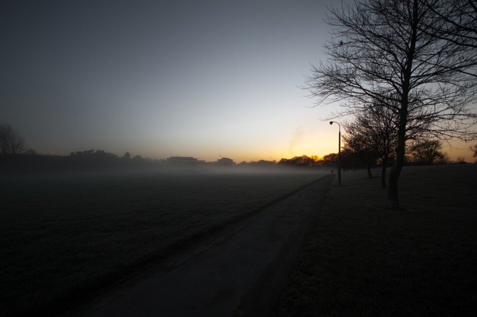 hint of city skyline at dawn with fog and sunrise