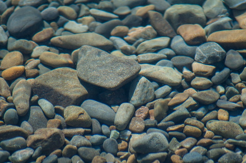 rocks and stones just under the water