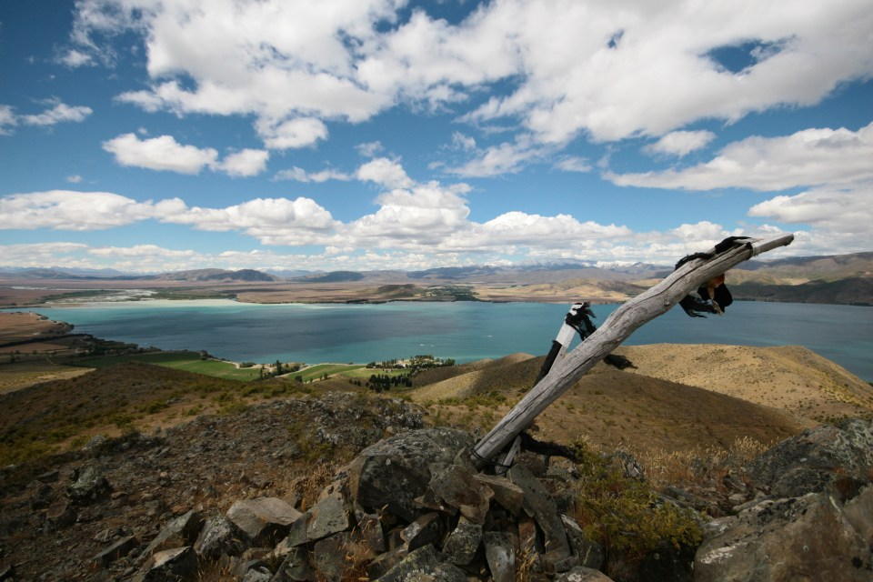view from the top of a hill above lake benmore, canterbury, new zealand
