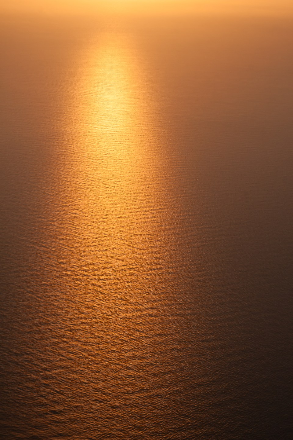 ripples in the sea from a plane at sunrise