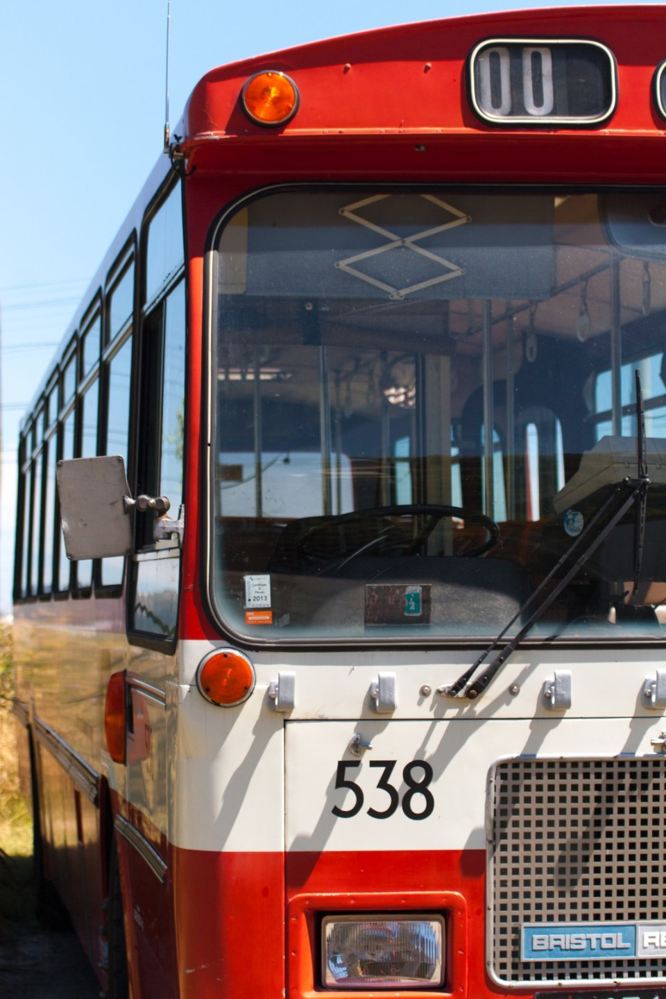 old vintage red and white bus number 538