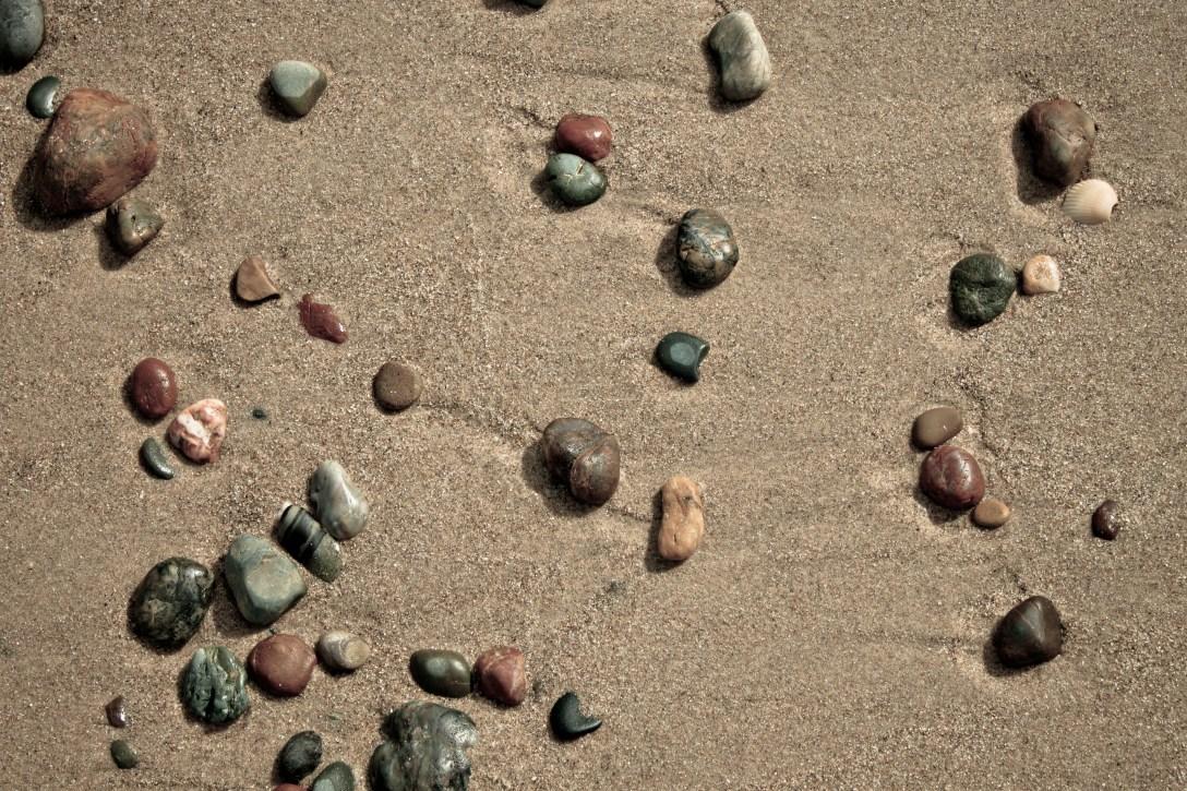 stones sand stuck small