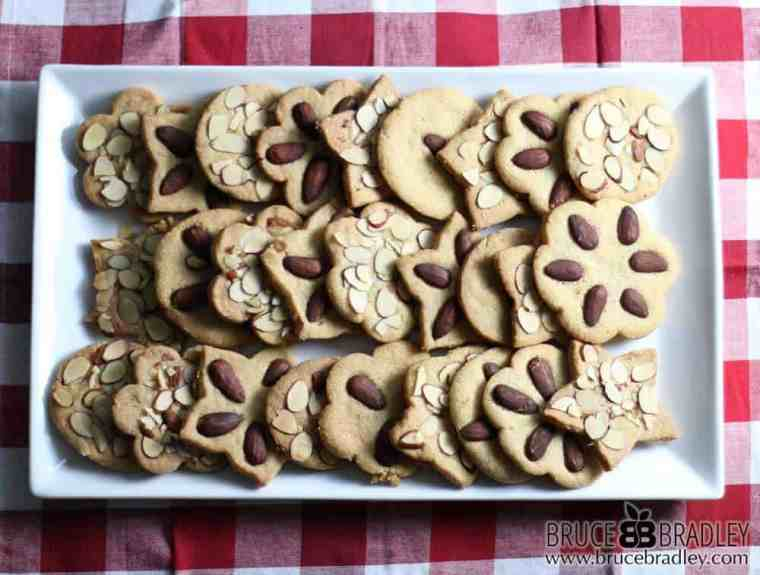 Who needs all those artificially colored sprinkles and frostings when you can bake up a delicious, gorgeous batch of these Almond Shortbread Cookie Crisps. Decorated with real almonds, these cookies are simply amazing!