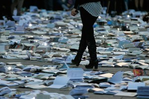 Bucharest, romania: A woman walks between books displayed on the pavement d