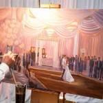 Live schilder maakt schilderij van een bruiloft
