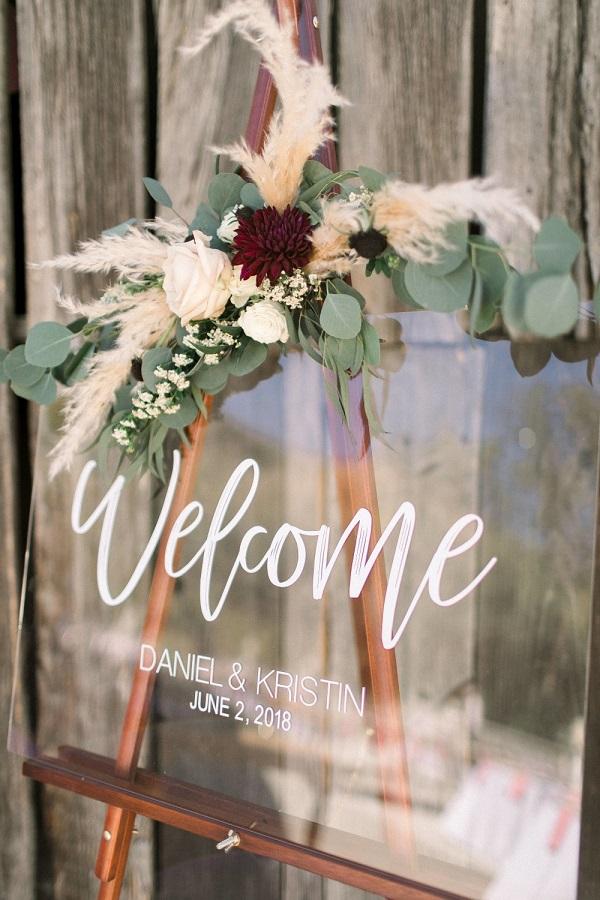 Glazen welkomstbord bruiloft