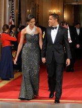 WASHINGTON - FEBRUARY 22: U.S. President Barack Obama and first Lady Michelle Obama enter the East Room for entertainment after a black-tie dinner at the White House on February 22, 2009 in Washington, DC. The Obamas gave their first formal White House dinner as hosts to the National Governors Association which has been holding their 2009 winter meeting discussing Obama's stimulus program, health care, infrastructure and education. (Photo by Mike Theiler-Pool/Getty Images)