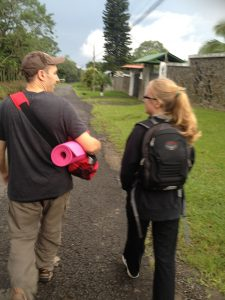 Walking Calle Vargus in Alajuela Costa Rica with an assortment of yoga mats