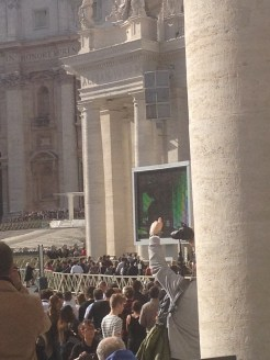 We could see the pope on the movie screen on the right.