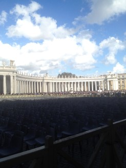 "This is one ""arm"" of St. Peter's Square. Notice all the people lined up near the columns. They're waiting in line to go into St. Peter's Basilica."