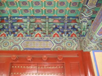 Ornate and colorful designs on the ceiling of a building in the Forbidden City in Beijing.