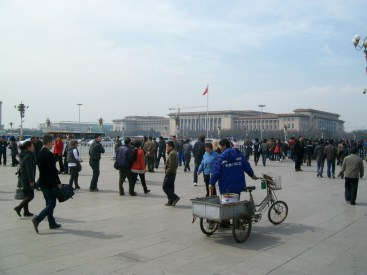 There's always something interesting happening in Beijing... what's the guy with the bike and a bike-trailer doing?