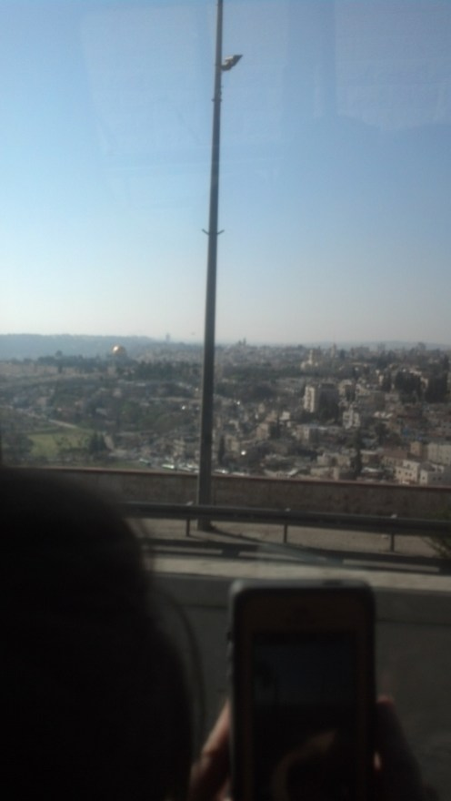 Driving in Jerusalem, Israel. You can see the Temple Mount in this picture (if you look closely).