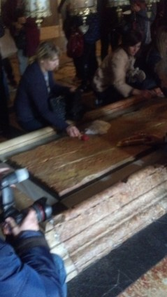 The Stone of Anointing in the Church of the Holy Sepulchre in Jerusalem, Israel.