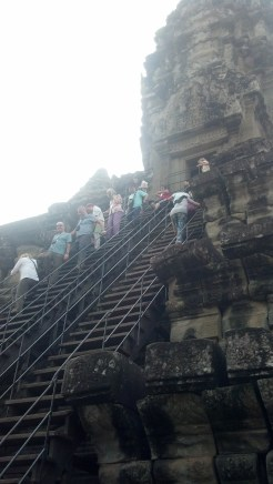 Yes, you can go into some of the old temples at Angkor Wat. But, you have to be willing to wait in line for an indefinite period of time (the line went all the way around this structure at least once).