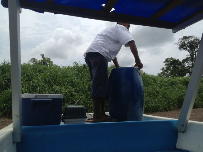 One of the drivers on our boat from Tortuguero works with a barrel.