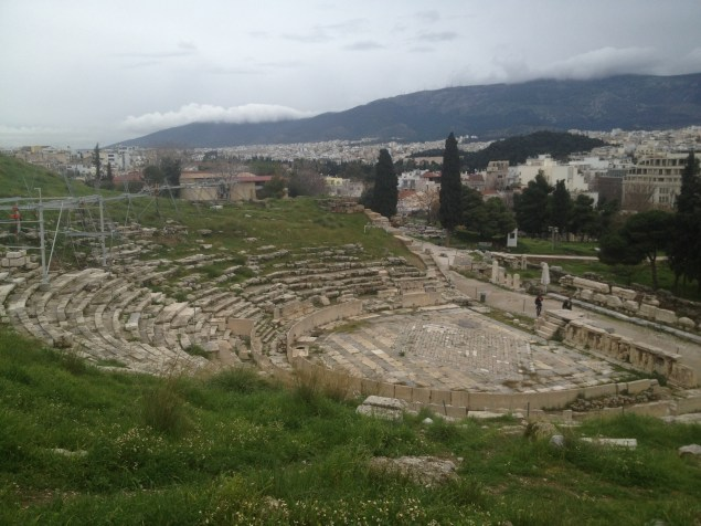 Looking down at the Theater of Dionysus. Although the Odeon of Herodes Atticus was off-limits for climbing and exploring, you were able to sit on the stone seats at the Theater of Dionysus and look out at Athens.