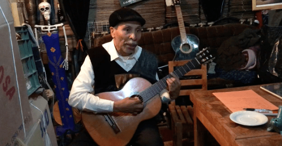 The professor teaches Lydian new songs whenever he has time. This lesson took place at a bar.