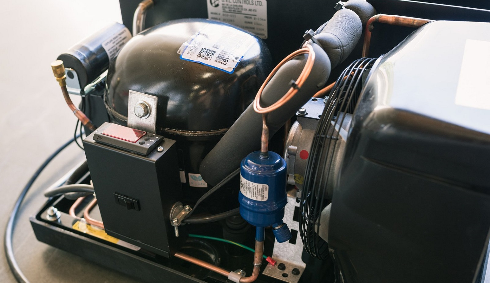 A solution of 1/3 propylene glycol and 2/3 water is placed in the 3 gallon reservoir and kept cold by a copper refrigerant line. Small pumps submersed in ...