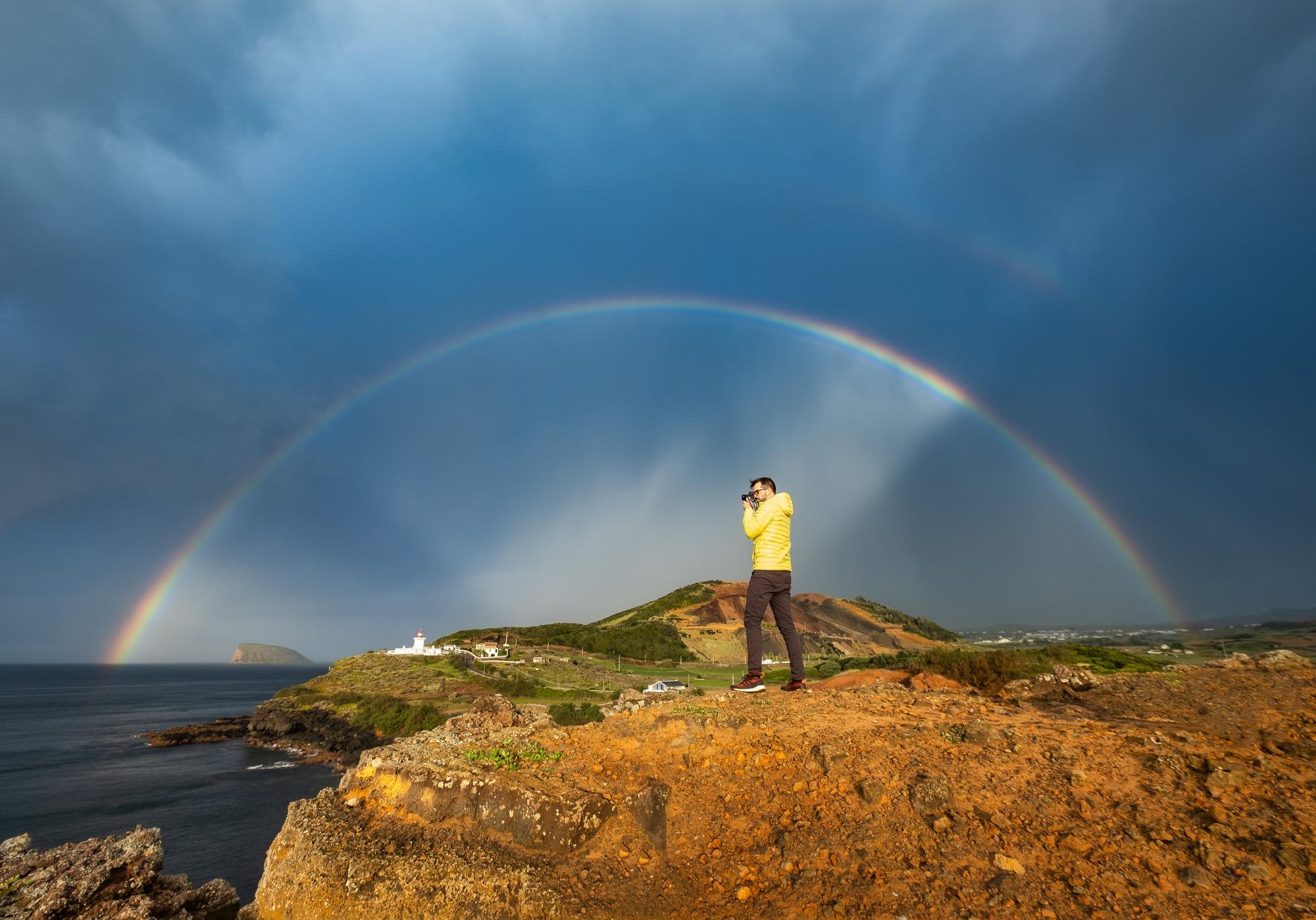 Photographer inside rainbow at Ponta das Contendas, Terceira Island, Azores