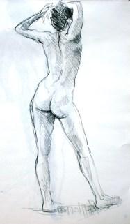 Fabienne debout de dos déhanchée