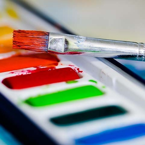 acrylic paints with paint brush being used
