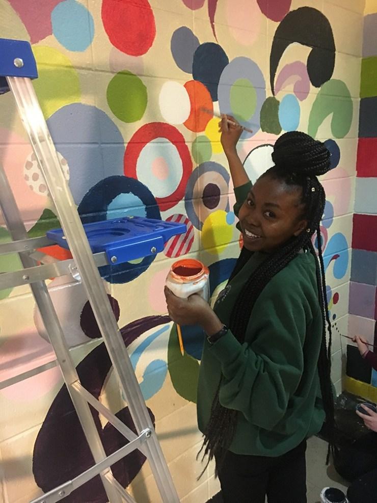 uplifting mural painted at homeless shelter