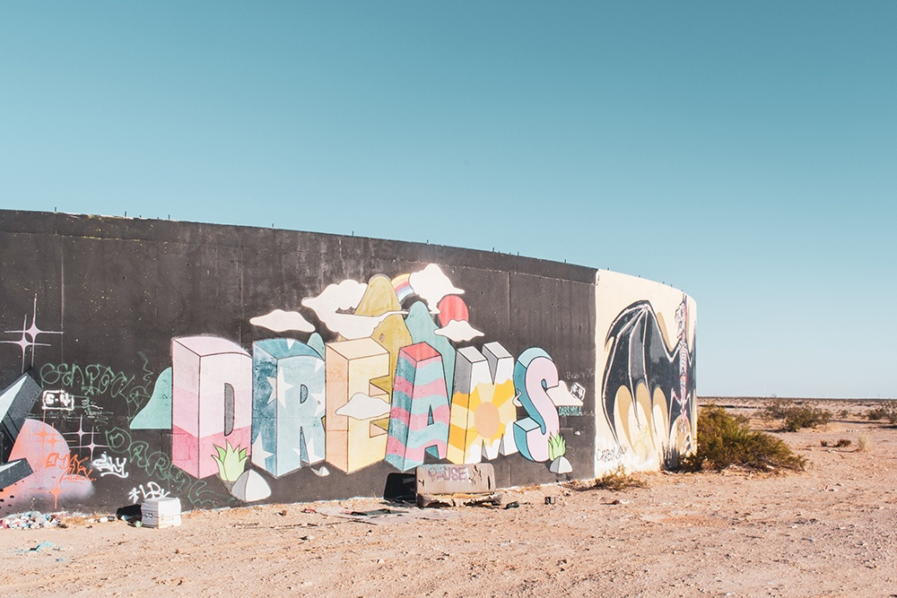 Dreams graffitied on wall, decorative