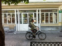 Shopfront with cyclist