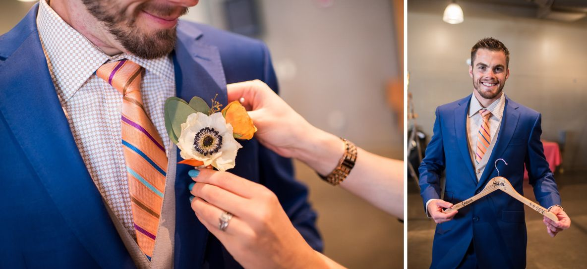 Groom gets boutonniere pinned on.