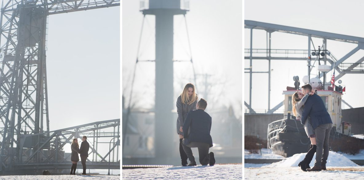 Surprise winter proposal outside with bridge in background.