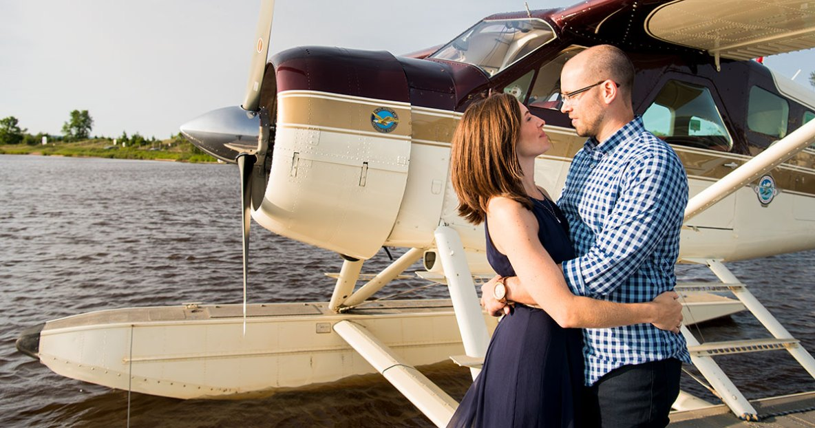 Engagement photos in a DeHavilland Beaver seaplane.