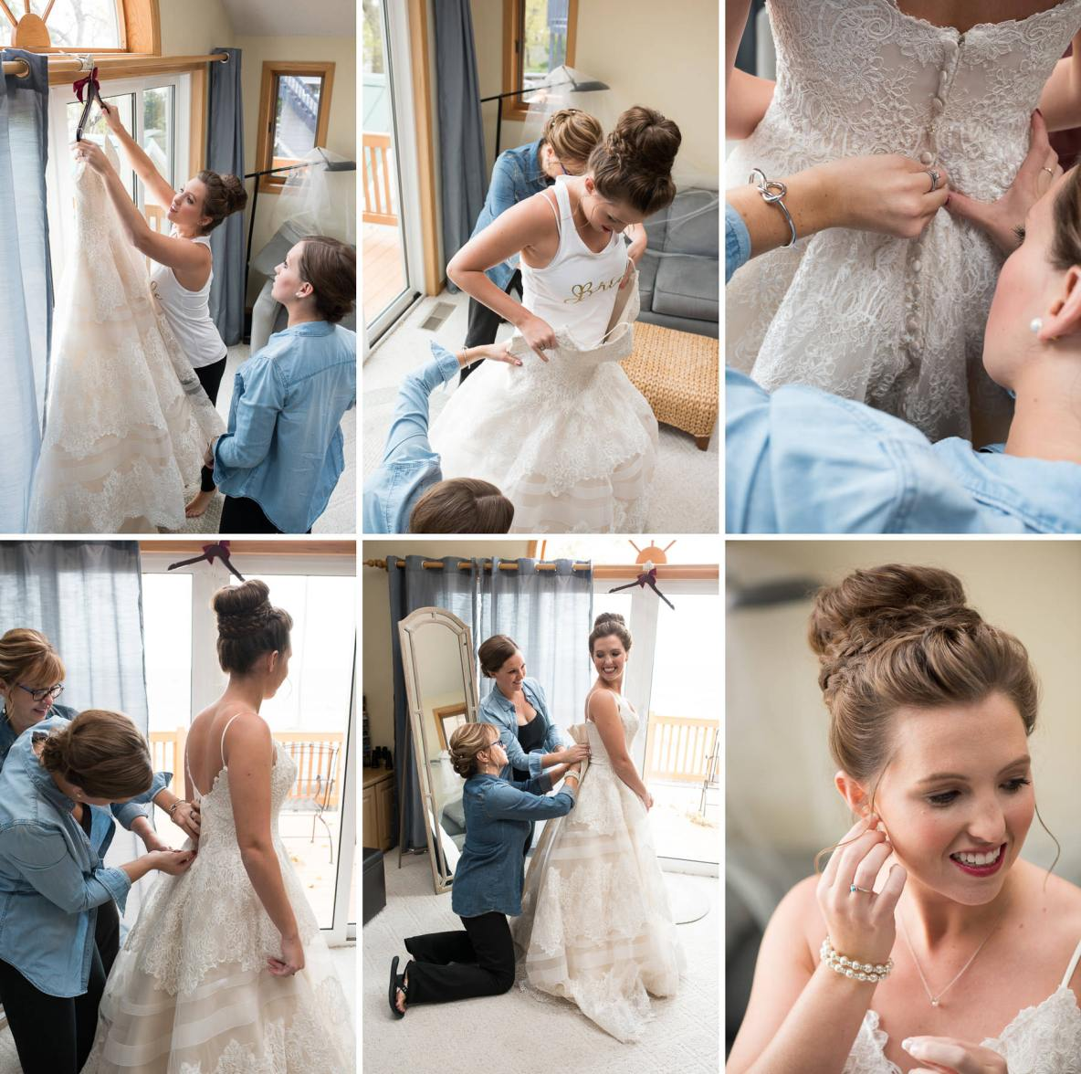Bride gets dress fastened by bridesmaids.