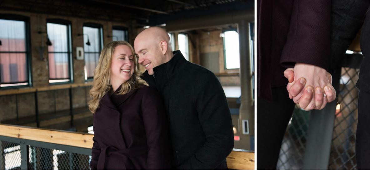 Indoor engagement photos, couple holding hands and smiling.