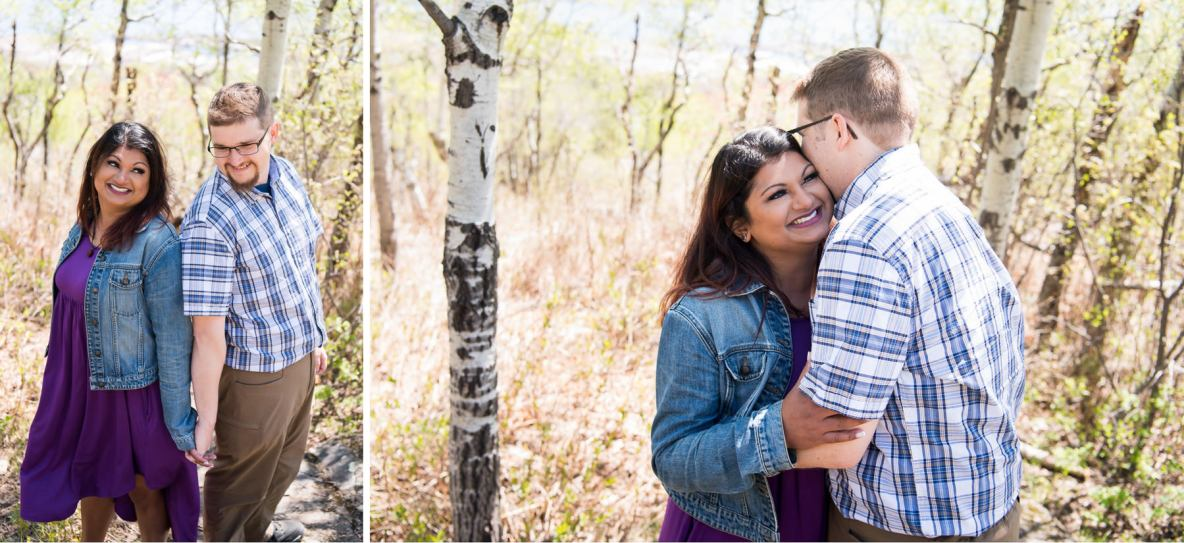 Outdoor engagement session with green trees in background.