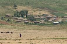 A lone Maasai man walks in the plains near his village outside of Arusha, northern Tanzania.