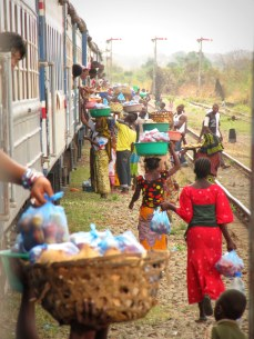 """Vendors at a train stop in central Tanzania, from """"Don't Talk to Strangers"""""""