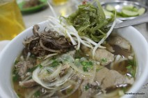 bun bo hue with banana leaf, bean sprout, and rau moung