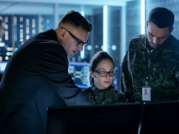 3 people working at an operations center