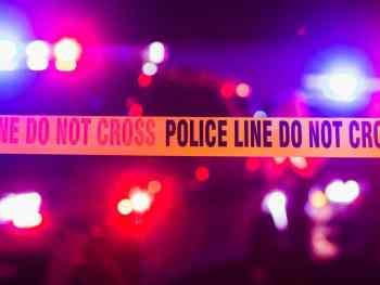 Crime Scene Tape w/ Police Lights at Night