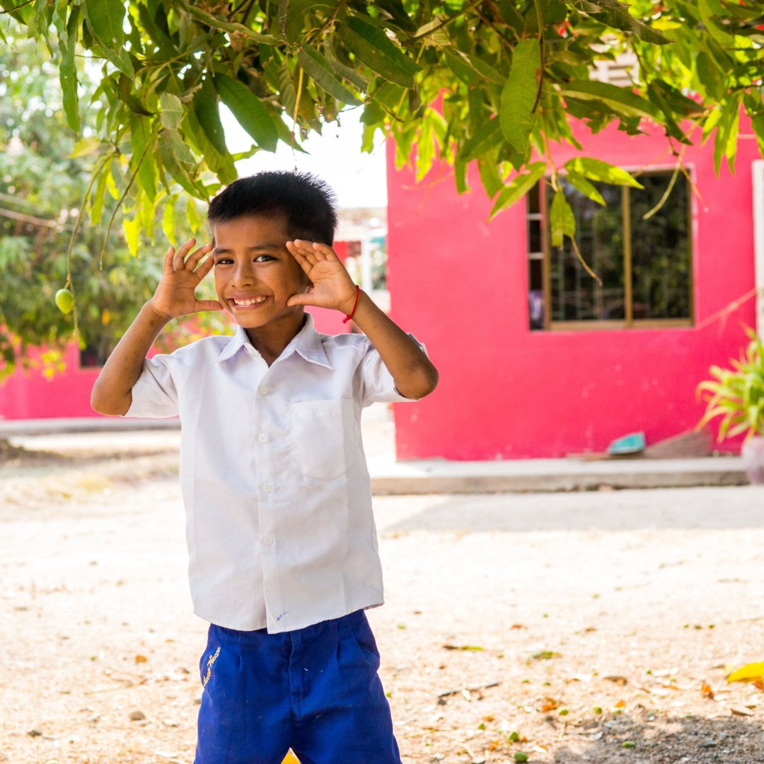 A child poses at New Hope for Cambodian Childrens Village