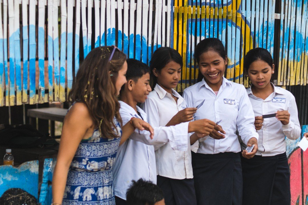 Female students pose with their teacher at the CESHEO Svay Thom campus near SIem Reap, Cambodia