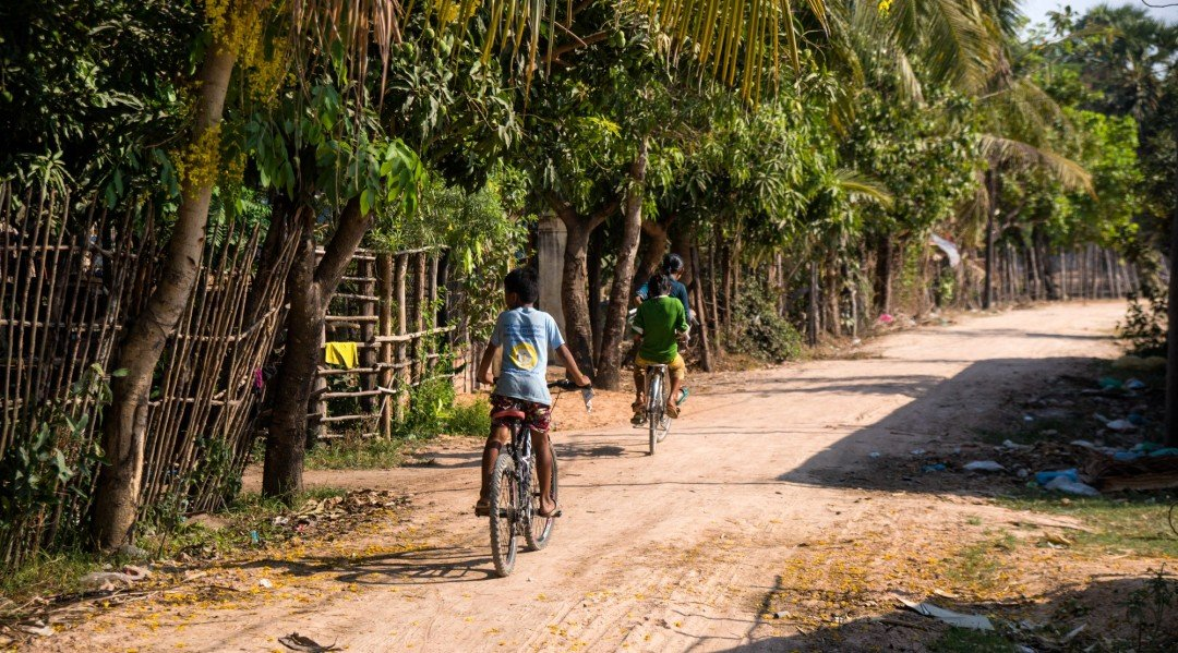 students ride home from class at the CESHEO Bakong Campus, near Siem Reap, Cambodia